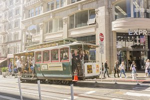 Tourists enjoying cable car in SF