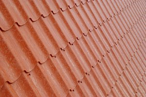 Wall of textured red tile.
