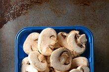 Tub of Sliced Mushrooms