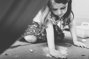 Young Girl Coloring with Chalk BW