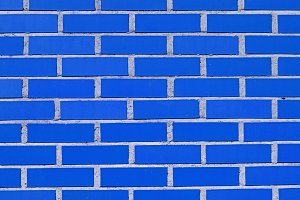 Detail of a blue brick wall