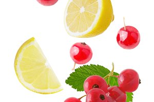Flying lemon and berries isolated on