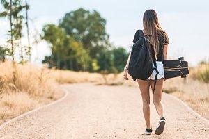 Beautiful young woman walking to the