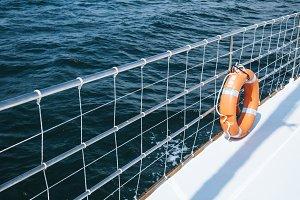 Boat yacht at sea and lifebuoy