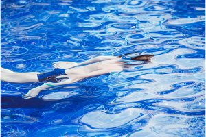 Young man swimming in the pool