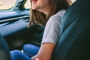 Girl laughing in the car