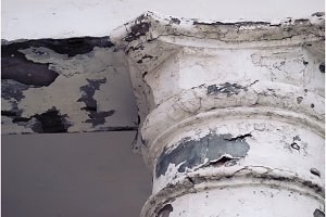 Old abandoned cracked column capital