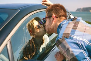 Young couple kissing through the gla