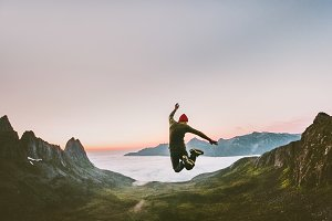 Jumping man in mountains vacations