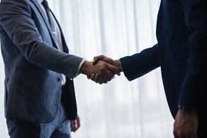 Businessmen handshaking after good
