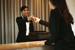 Female guest taking room key card