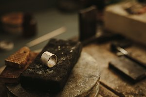 Ring on jeweler working table