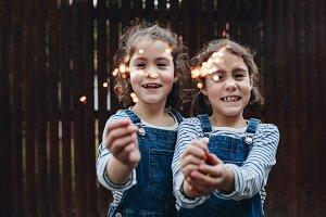Little girls holding sparklers