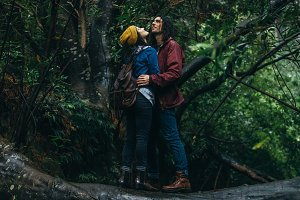 Couple in love getting wet in rain