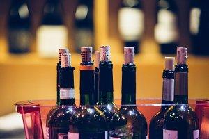 Close up of opened wine bottles