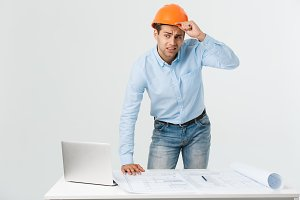 Stressed young constructor having