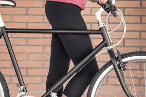 Customized bike and sportive woman