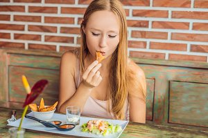 Woman eating at the cafe. Lifestyle