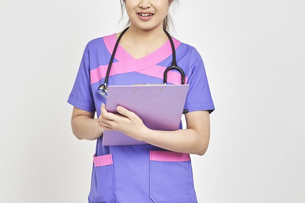 doctor with a folder in uniform sta…
