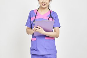 doctor with a folder in uniform stan