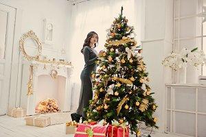 Young stylish girl with Christmas gi