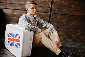 Young fashion man with the suitcase