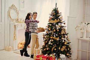 Young stylish couple with Christmas