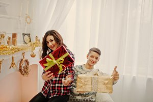 Young stylish couple with Christmas