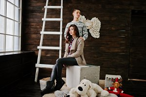Young fashion winter  couple at wood