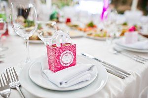Small pink box with candies at table