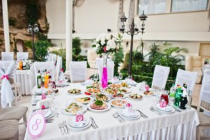 Wedding guest table with flowers and