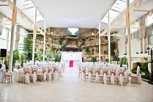 Wedding guest chairs with pink ribbo