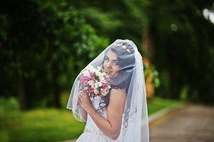 Charming brunette bride under veil w
