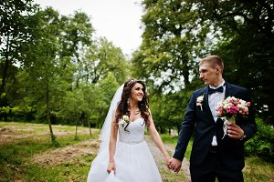 Young stylish wedding couple in love
