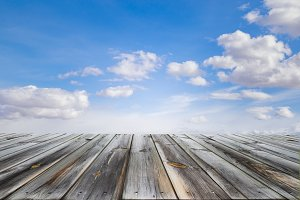 Wooden table top with blue sky
