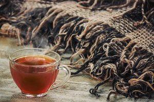 a cup of tea on a cozy autumnal back