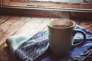 hot tea in the pot near the window.