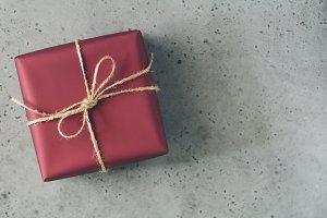 Gift box in a red wrapping paper