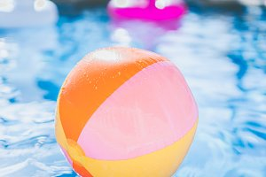 Inflatable beach ball in the pool
