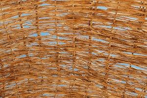 through a straw umbrella from the su
