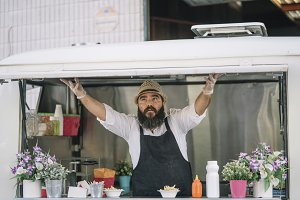 Big man with beard and hat serves fo