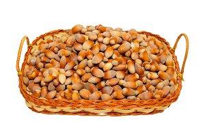 Heap of filberts in wicker basket