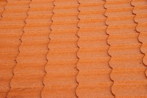 Wall of textured red tile