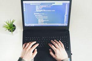 Young man programming code.