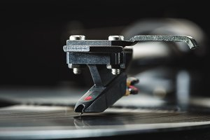 Tonearm with background cartridge.