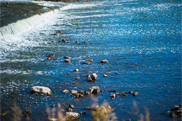 Wild vivid River with rocks and