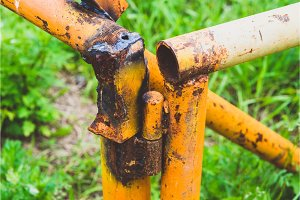 old rusty yellow pipe on a