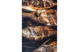 Grilled fish with lemon on the grid