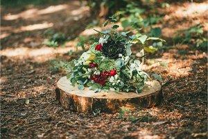 Wedding flower bouquet on wooden log
