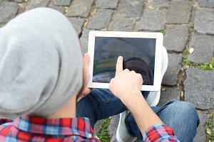 latin man using a tablet.